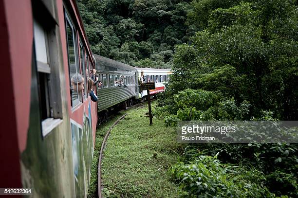 Tourists take pictures while traveling from Curitiba to Morretes on the SerraVerde Express train The Serra Verde Express train travels along 110 km...