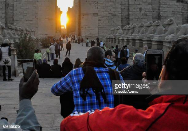Tourists take place to watch the winter solstice as sunlights become the herald of winter during the sunrise at Karnak Temple in Luxor Egypt on...