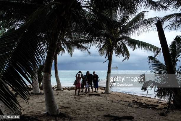 Tourists take selfies at the beach in Mahahual Quintana Roo State on August 8 2017 after tropical storm Franklin made landfall on Mexico's Yucatan...