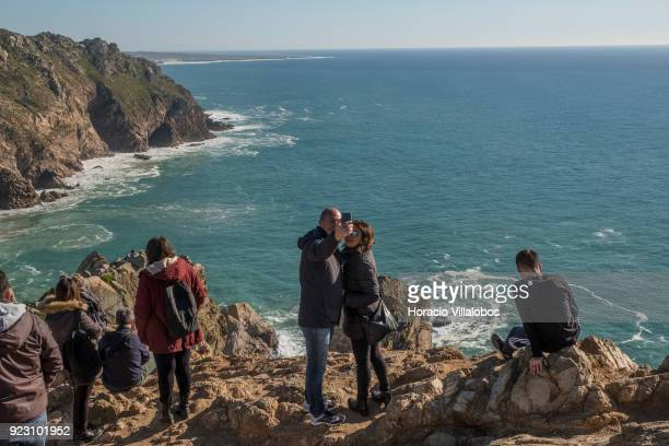 Tourists take selfies on a sunny winter afternoon in Cabo da Roca on February 22 2018 in Sintra Portugal Cabo da Roca is a cape which forms the...
