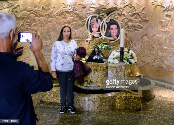 Tourists take souvenir photographs at a memorial to Princess Diana and Dodi Fayed at Harrods department store in London England The memorial was...