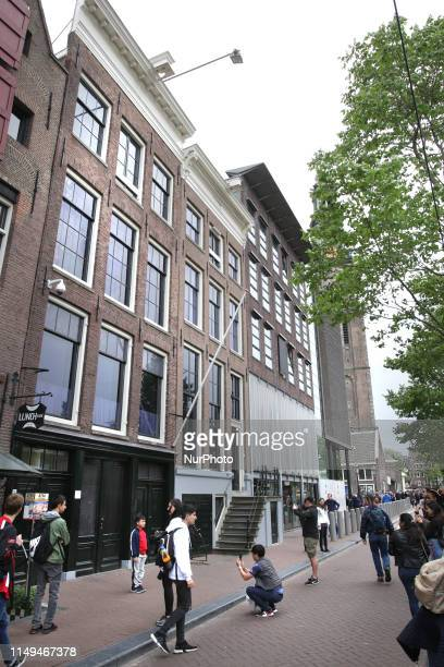 Tourists take the pictures at the Anne Frank houseremembering Anne Frank's 90th Birthday on June 12 2019 in AmsterdamNetherlands Today it is exactly...