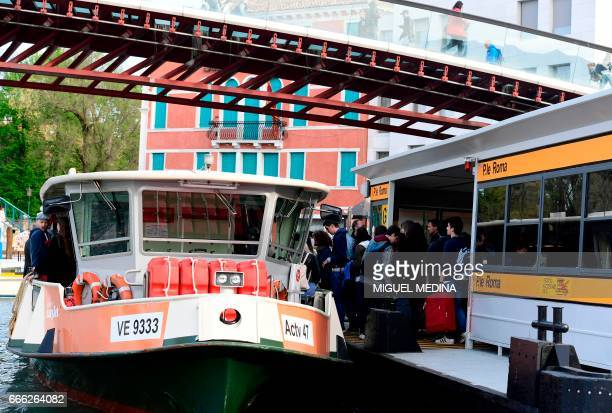 """Tourists take the """"Vaporetto"""", or bus-boat at the Canal Grande in Venice on April 7, 2017."""