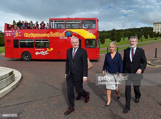 Tourists takes pictures from a sight seeing bus as Northern Ireland Deputy First Minister Martin McGuinness and Sinn Fein President Gerry Adams make...