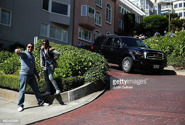 Tourists takes selfie while standing Lombard Street on May 20 2014 in San Francisco California The San Francisco Municipal Transportation Agency...