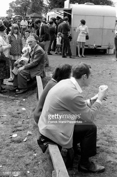 Tourists taking a break near refreshment vans at Woburn Abbey and Gardens in Bedfordshire, circa July 1969. From a series of images to illustrate the...