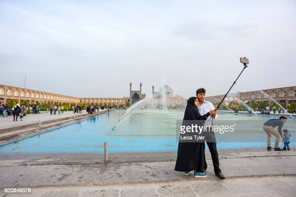 Tourists taking a selfie at Maydane Imam Square also known as Naqshe Jahan Square in Esfahan Iran It is a UNESCO World Heritage Site