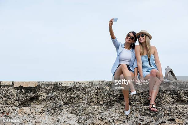 Tourists taking a selfie while traveling in Cartagena