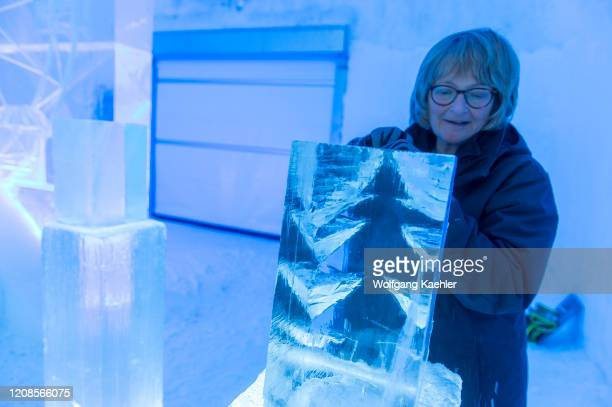 Tourists taking part in an ice sculpting class at the ICEHOTEL 365 which was launched in 2016 and is a permanent structure offering year round the...