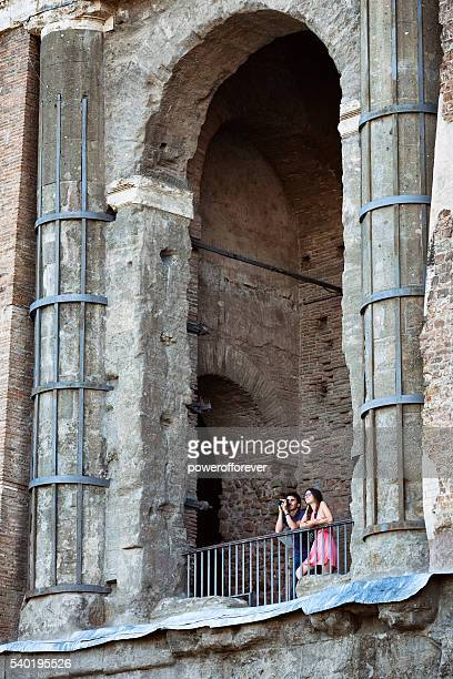 Tourists taking photos at the Roman Forum in Rome, Italy