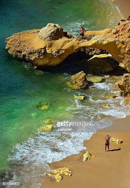 Tourists taking photos in a beautiful beach in Algarve