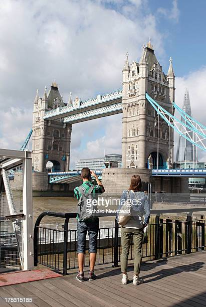 Tourists taking photos of Tower Bridge and The Shard. London, July 28th 2013