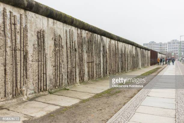 tourists taking pictures at the berlin wall memorial in germany. - istock stock pictures, royalty-free photos & images