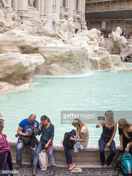 FOUNTAIN ROME LAZIO ITALY Tourists taking selfies at the Trevi Fountain in Rome Italy