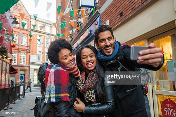 Tourists Taking Selfies on Vacation in Dublin Ireland