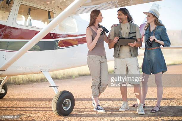 tourists talking beside plane, wellington, western cape, south africa - khaki stock pictures, royalty-free photos & images