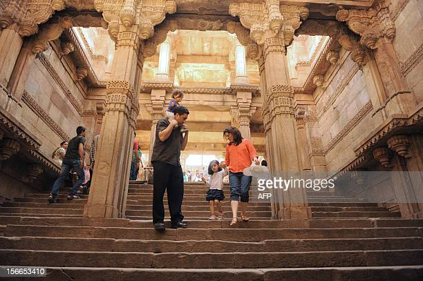 Tourists throng the 'AdalajNiVav' stepwell in Adalaj in Gandhinagar district some 35kms from Ahmedabad on November 18 on the eve of World Heritage...