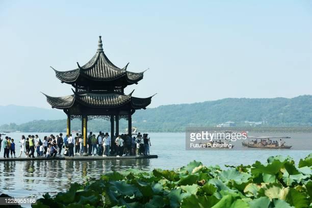 Tourists throng the Jixian Pavilion Bridge in the West Lake. Hangzhou city, Zhejiang Province, China, October 2, 2020.- PHOTOGRAPH BY Costfoto /...