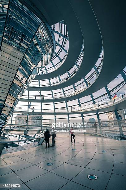 CONTENT] Tourists tour the large glass dome at the top of the Reichstag building which provides a panoramic view of Berlin