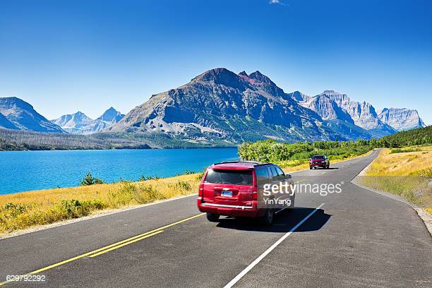 Tourists Touring Glacier National Park in a Driving Road Trip