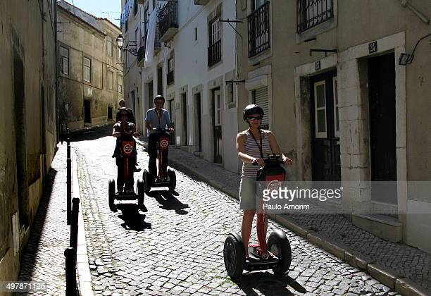 Tourists touring with electric segways at Alfama in Lisbon, Portugal.