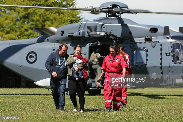 Tourists trapped by the Kaikoura earthquakes arrive by military helicopters at Woodend School grounds on November 15 2016 in Christchurch New Zealand...