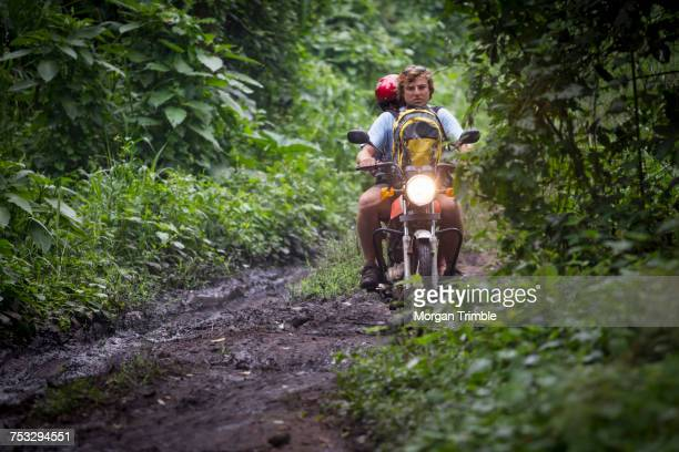 Tourists travel by motorcycle, Lake Kasenda, Crater Lakes Region, Uganda