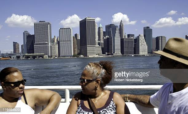 Tourists travel on a ferry boat July 17 2011 from a Brooklyn pier to Governors Island across New York Harbor at the tip of lower Manhattan Control of...
