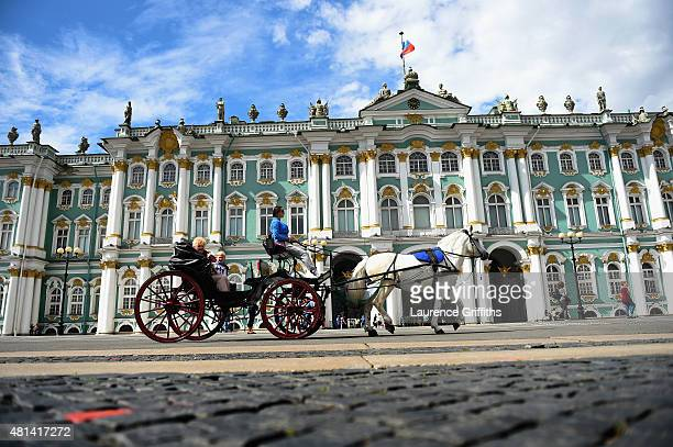Tourists travel through Palace Square by Horse and Carriage during a media tour of Russia 2018 FIFA World Cup venues on July 20 2015 in Saint...
