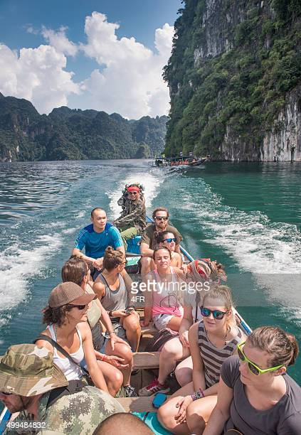tourists traveling by longtail boat, khao sok, thailand - kao sok national park stock pictures, royalty-free photos & images