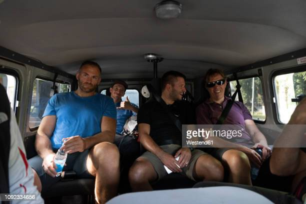 tourists traveling in a van - five people stock pictures, royalty-free photos & images