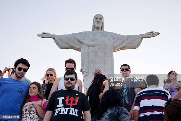 tourists under statue of christ the redeemer in rio, brazil - corcovado stock pictures, royalty-free photos & images