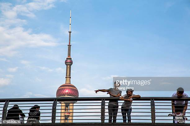 Tourists under the Oriental pearl tower which is the landmark of Shanghai Pudong