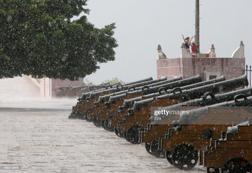 Tourists under the rain at Morro Castle in Havana, Cuba, on August 26, 2010.