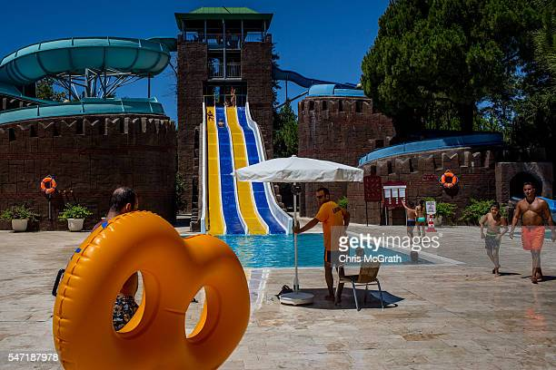 Tourists use a waterslide at an all inclusive Russian themed resort on July 12 2016 in Antalya Turkey Russian President Vladimir Putin last month...