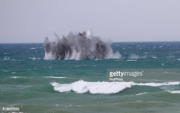 Tourists uses a cell phone to take pictures and watch like an attraction fired ground to air missile and millitary helicopters and jet fighters in...
