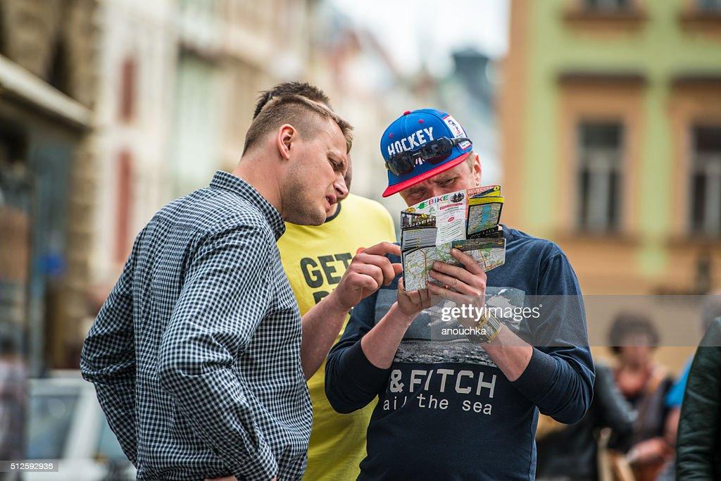 Tourists using city map on Prague Street : Stock Photo