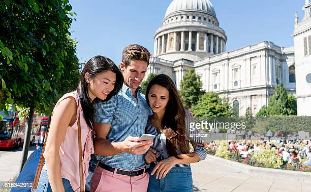 Tourists using maps app on a cell phone