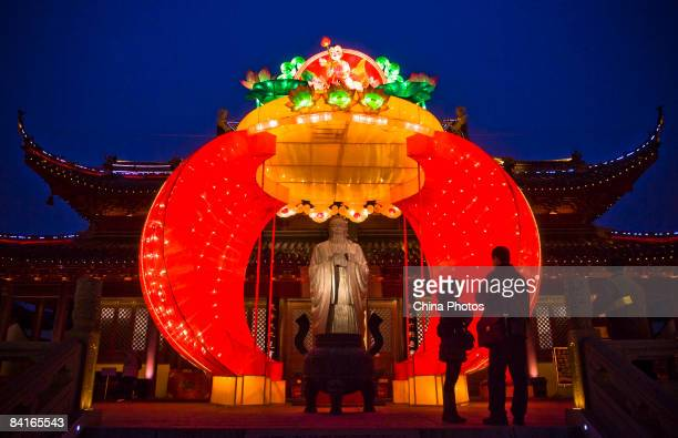 Tourists view a lantern at the Great Perfection Hall of the Confucius Temple on January 3 2009 in Nanjing of Jiangsu Province China Chinese People...