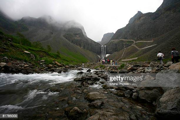 Tourists view a waterfall at the Erdaobaihe Township on June 30 2008 in Antu County of Yanbian Korean Autonomous Prefecture Jilin Province China The...