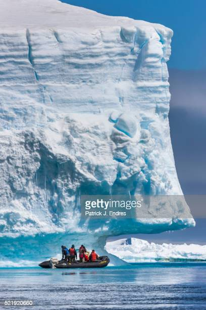 Tourists view giant icebergs