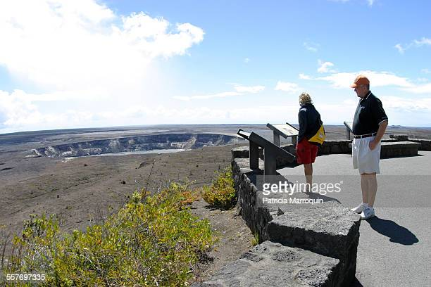 Tourists view Halemaumau Crater a crater within the larger summit caldera of Kilauea Hawaii Volcanoes National Park Big Island Hawaii Image taken in...