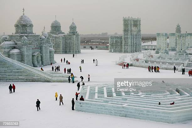 Tourists view ice buildings on display in the Grand Ice and Snow World at 23rd Harbin International Ice and Snow Festival on January 5 2007 in Harbin...