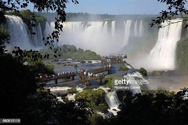 Tourists view Iguassu Falls from walkway, Brazil