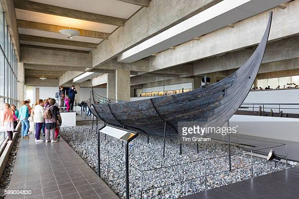 Tourists view Sculdelev original longboat exhibit at Roskilde Viking Ship Museum on June 21 2015 in Zealand Denmark