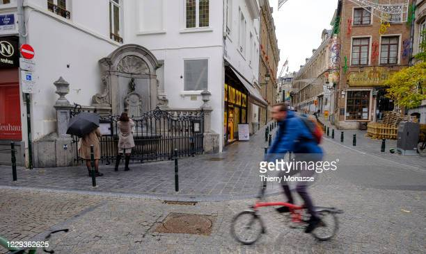 Tourists view the bronze fountain sculpture Manneken Pis, on October 28 in Brussels, Belgium. On October 29, the Interministerial Conference on...