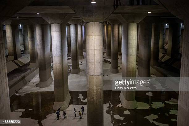 Tourists view the enormous pressureadjusting underground water tank during a tour of the Metropolitan Area Outer Underground Discharge Channel...