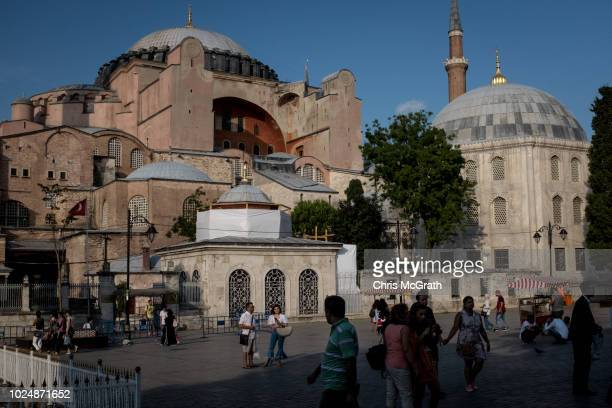 Tourists view the Hagia Sophia in the Sultanahmet tourist district on August 28 2018 in Istanbul Turkey The Turkish Lira continued to weaken Tuesday...