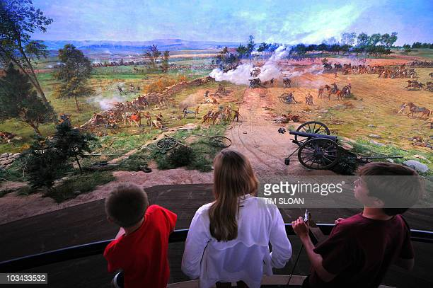 Tourists view the newly restored cyclorama painting an immersive 360° cylindrical painting which places the viewer in the middle of Picket's Charge...