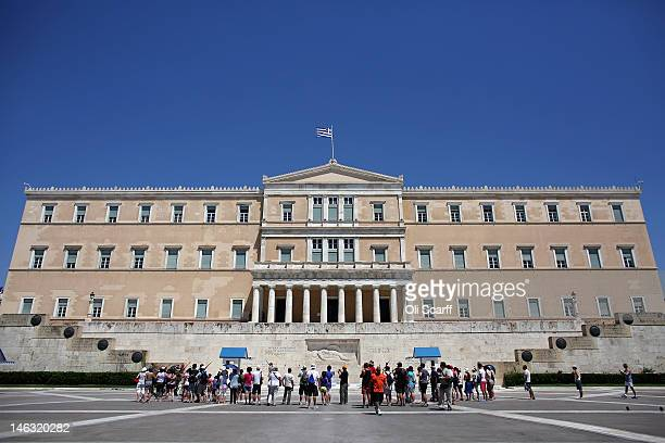Tourists view the Parliament building from Syntagma Square on June 14, 2012 in Athens, Greece. The Greek electorate are due to go to the polls in a...